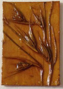 Jacky Lowry artist and printmaker, tiny collagraph printing plate of kangaroo grass seed heads.