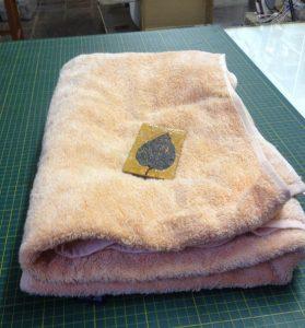 Jacky Lowry artist and printmaker, water-sprayed printmaking paper sitting between dampened towel overnight.