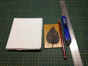 Jacky Lowry artist and printmaker, printmaking paper cut to size for printing tiny collagraph plate.