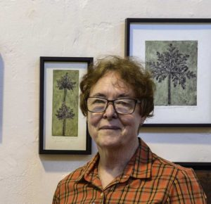 Jacky Lowry with hand coloured collagraph prints. Art. Printmaking.